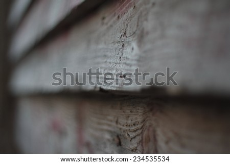 Grunge grey wooden background out of focus with perspective and selective focus on a little part of wood texture. - stock photo