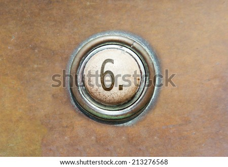 Grunge image of a button from the control area - 6 - stock photo