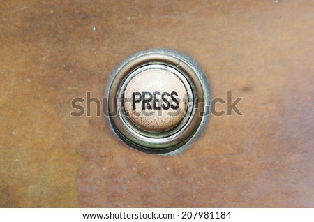 Grunge image of a button from the control area for an old elevator lift or doorbell - stock photo