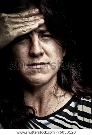 Grunge image of a very stressed woman suffering from depression or headache - stock photo