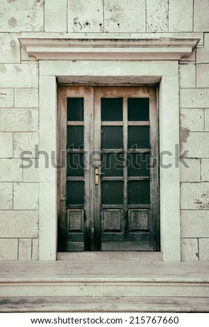 grunge image of an italian door. - stock photo