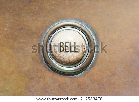 Grunge image of an old button - bell - stock photo