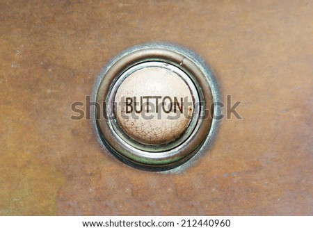 Grunge image of an old button - button