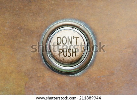 Grunge image of an old button - don't push - stock photo