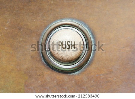 Grunge image of an old button - push - stock photo