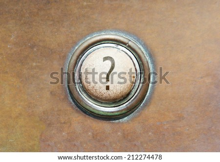 Grunge image of an old button - Questionmark - stock photo