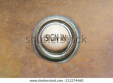 Grunge image of an old button - sign in - stock photo