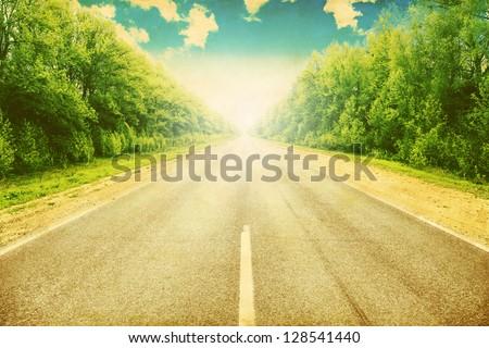 Grunge image of country asphalt road. - stock photo