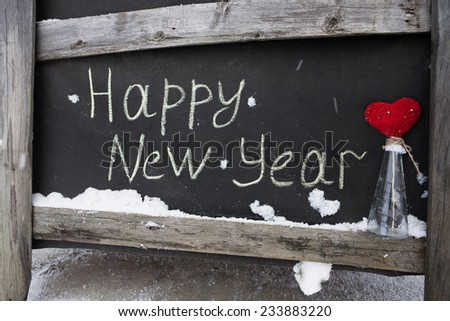 grunge inscription on the board happy new year