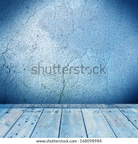 grunge interior - concrete wall and wood floor