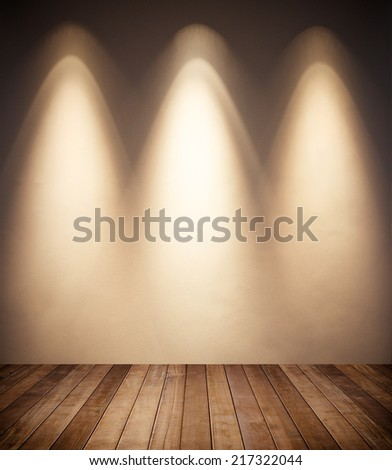grunge interior room with three spots. - stock photo