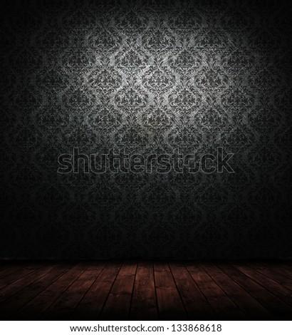 grunge interior with baroque wallpaper. - stock photo