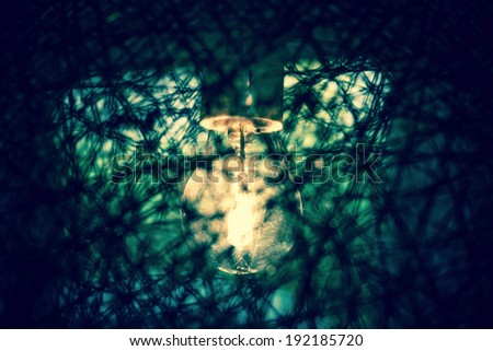 Grunge light bulb in faded colors - stock photo