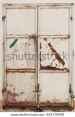 grunge metal lock door on the wall - stock photo