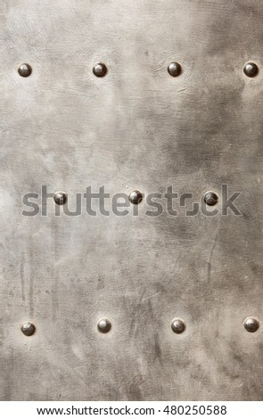 grunge metal plate or armour texture with rivets as background