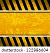 Grunge metal plate with warning stripes - stock photo