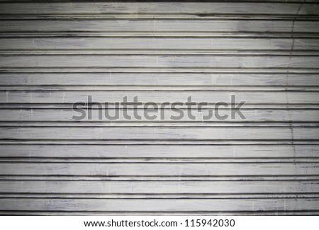 Grunge metal security roller door background - stock photo