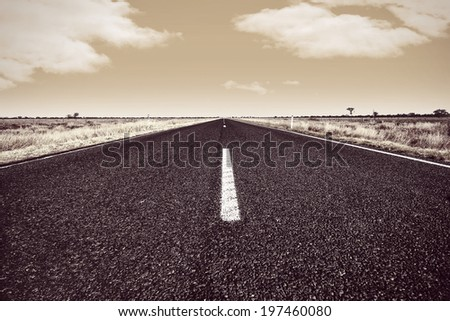 Grunge Monochrome Open Highway with a Cloudy Sky