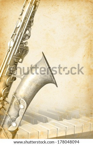 Grunge musical background with piano and a saxophone. Music concept with jazz musical instrument  on an old paper texture background. - stock photo