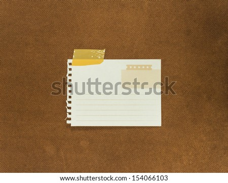 Grunge note papers over cork wood background