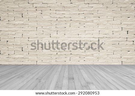 Grunge old aged brick wall painted in light cream beige color tone with wooden floor textured background in light grey color tone for interior backgrounds