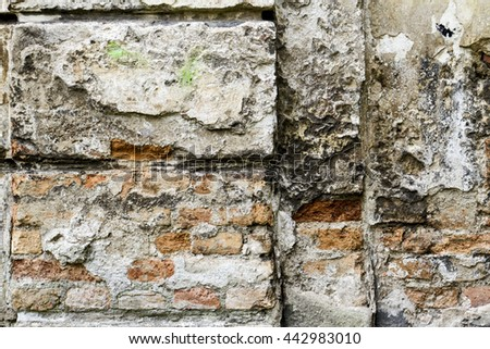 Grunge old bricklaying wall fragment from red bricks and damaged plaster background texture. Close-up - stock photo