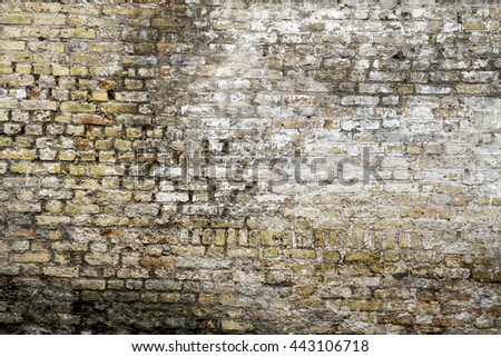 Grunge old bricklaying wall fragment from white bricks and damaged plaster background texture for text or image. Close-up - stock photo