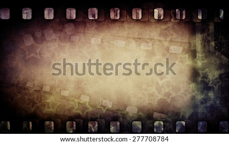 Grunge old film strip with stars. Vintage background - stock photo