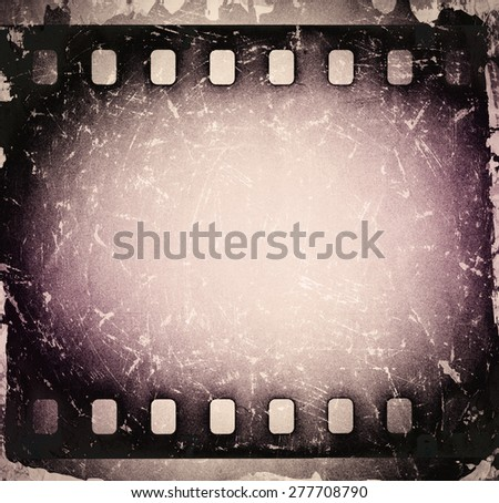 Grunge old scratched film strip. Vintage background - stock photo
