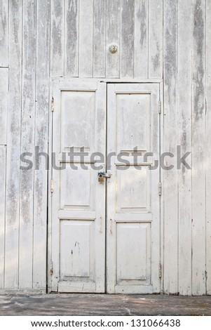 grunge old white door with lock - stock photo