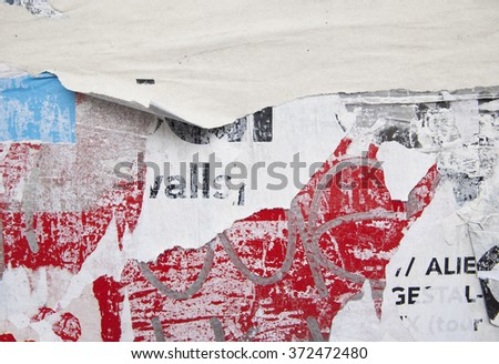 grunge on billboard with old ripped posters  - stock photo
