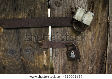 grunge padlock wooden. Old rusty iron lock on a wooden wicket gate