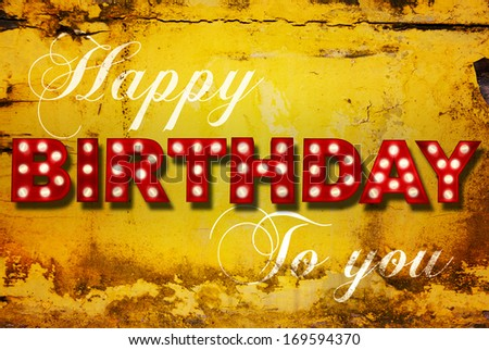 Grunge painted background with glowing letters writing Happy Birthday to you  - stock photo