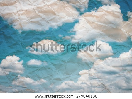 Grunge paper texture. with s white puffy clouds - stock photo