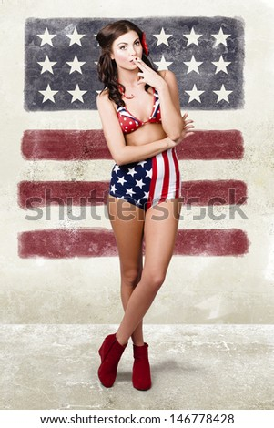 Grunge photo of a beautiful smoking hot young woman in full length with pin up makeup and hair style. American fashion style - stock photo
