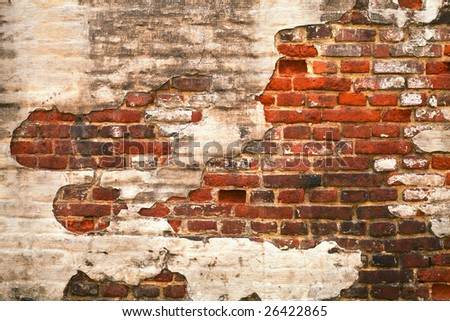 Grunge red brick wall texture with remaining plaster (stucco) - stock photo