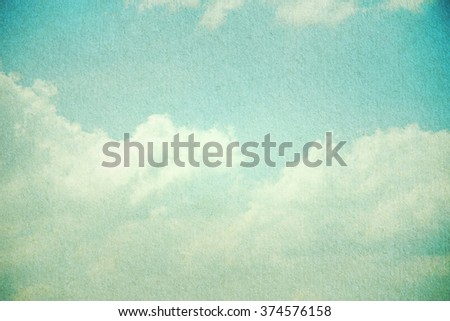 grunge retro sky and cloud background with paper texture - stock photo