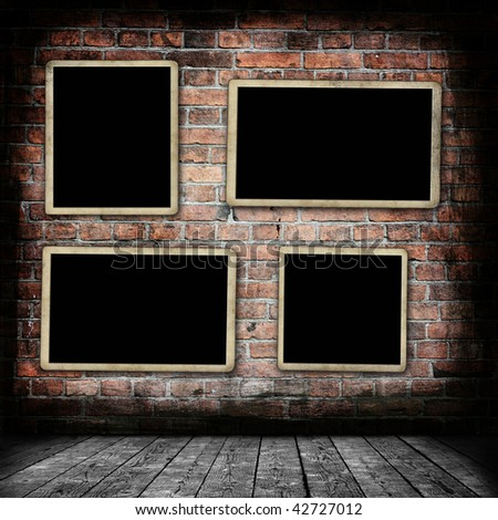 Grunge room with blank photo frames - stock photo