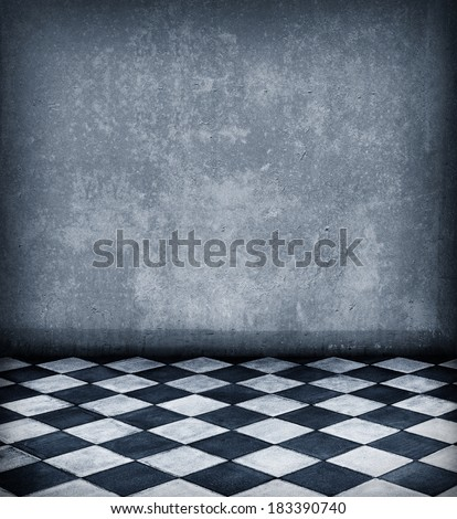 Grunge room with tiled floor - stock photo