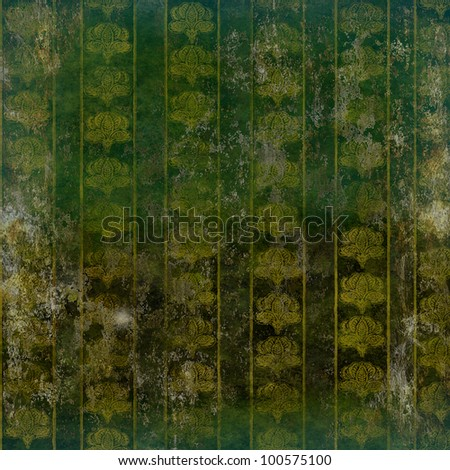 Grunge ruined wallpaper with vintage floral pattern gold on green - stock photo