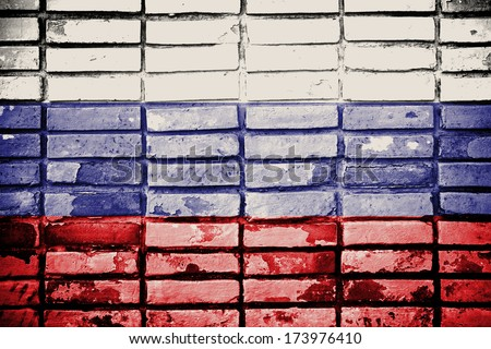Grunge Russia flag on old brick wall  - stock photo