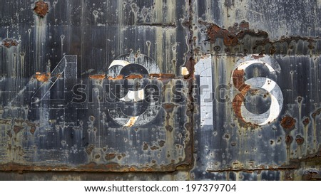 grunge rusty metal background with faded paint numbers