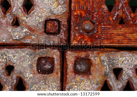 grunge rusty metal frames four corners with rivets, close-up
