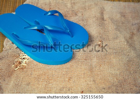 Grunge sacking background with flip flop sandals - stock photo