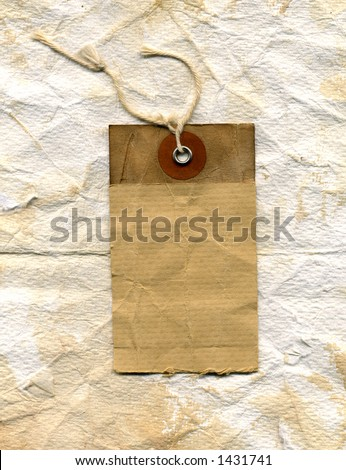 grunge shipping label. showing plenty of wear, stains and texture. on crumpled worn paper