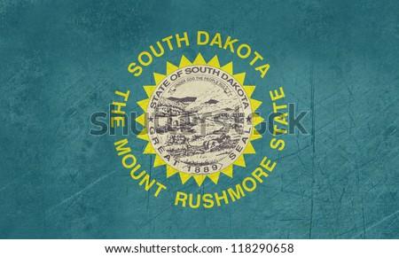 Grunge South Dakota state flag of America, isolated on white background. - stock photo