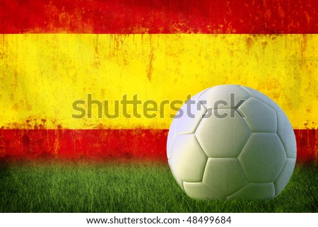 Grunge Spain flag on wall and soccer ball