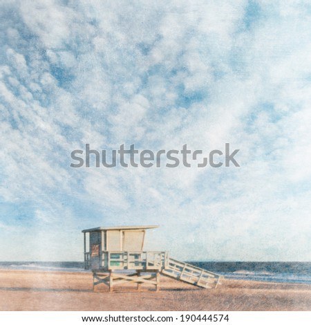 Grunge style beach background with lifeguard tower - stock photo