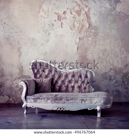 Beautiful Sofa In Classical Style On A Background Of Textured Walls.