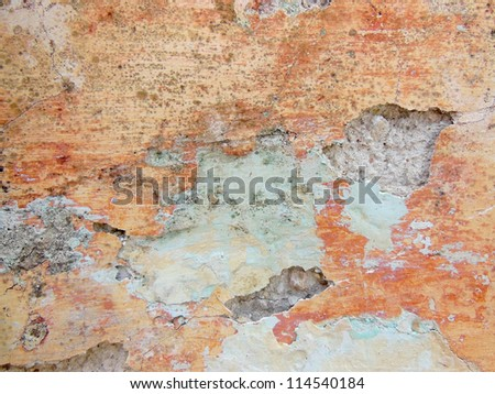 Grunge texture from crumbling plaster wall in Merida Mexico. - stock photo